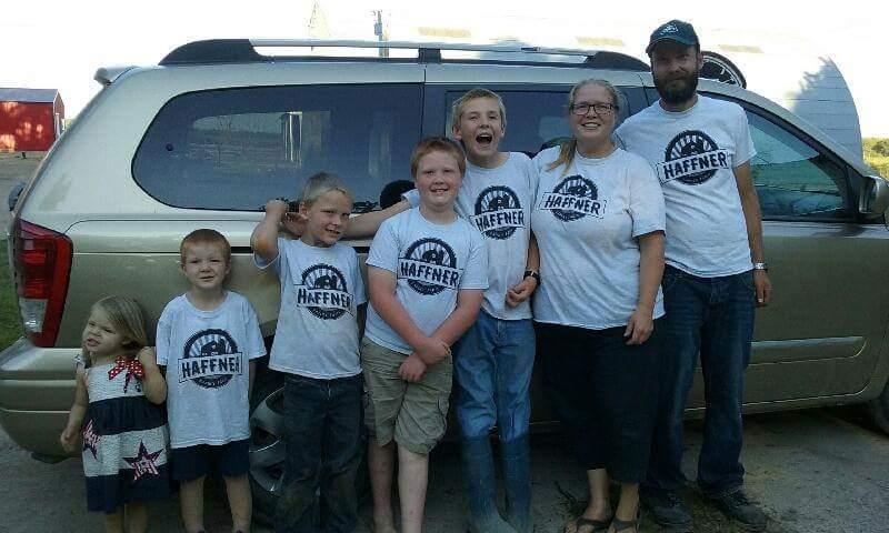 Haffner family posing by the van