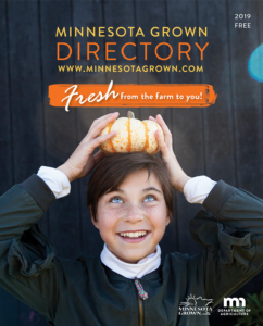 Minnesota Grown Directory cover image showing a boy with a small gourd on his head