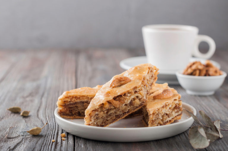 baklava on a plate with a coffee