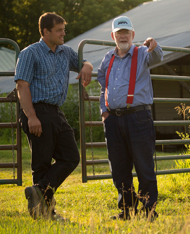 Lester and Mike talk on the farm