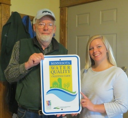 Mike holding the MN Ag Water Quality Sign