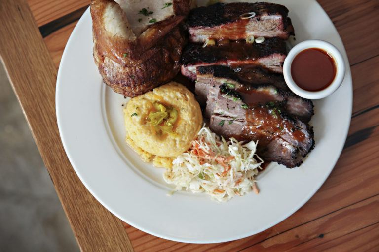 Barbeque ribs, chicken and coleslaw on a plate