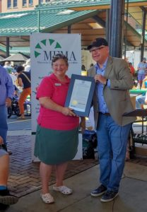 National Farmers Market Week 2019 declaration being held by Kathy Zeman and Governor Walzby