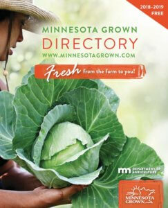 2018-2019 directory cover featuring a cabbage being plucked from a field