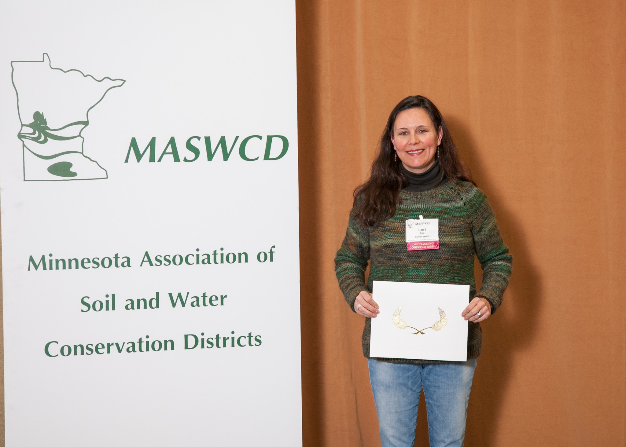 Lori of Roots Return Heritage Farm receives conservation award.